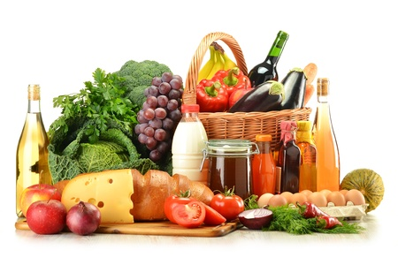 shopping baskets: Groceries in wicker basket including vegetables, fruits, bakery and dairy products and wine isolated on white Stock Photo