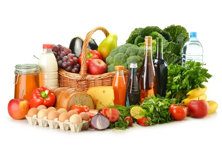 grocery baskets: Groceries in wicker basket including vegetables, fruits, bakery and dairy products and wine isolated on white Stock Photo