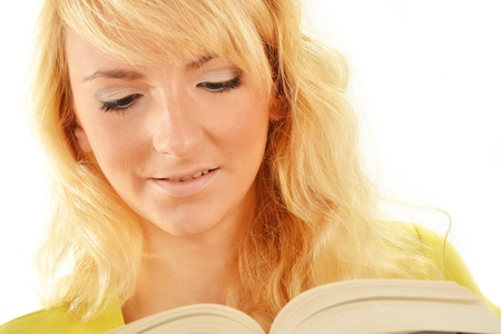 Portrait of young caucasian woman reading a book. Female student studying photo