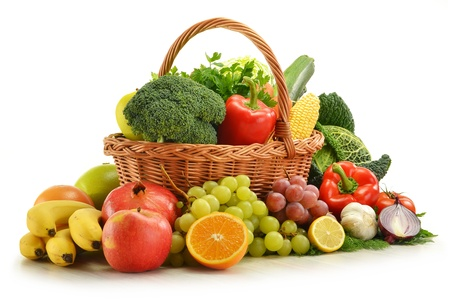 fruits basket: Composition with vegetables and fruits in wicker basket isolated on white