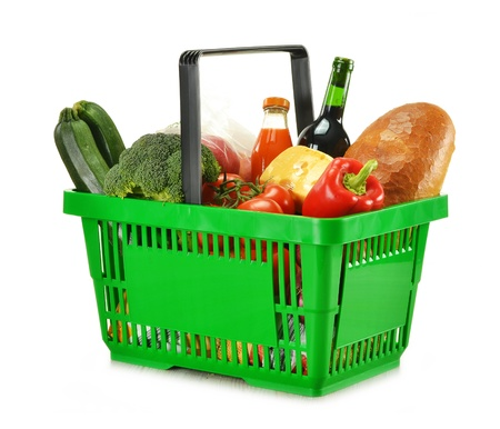 basket: Composition with shopping basket and groceries isolated on white