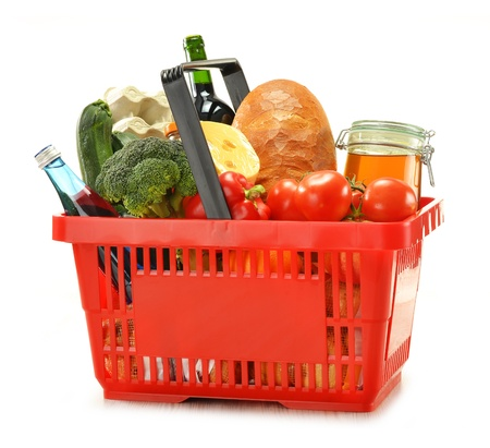 grocery cart: Composition with shopping basket and groceries isolated on white