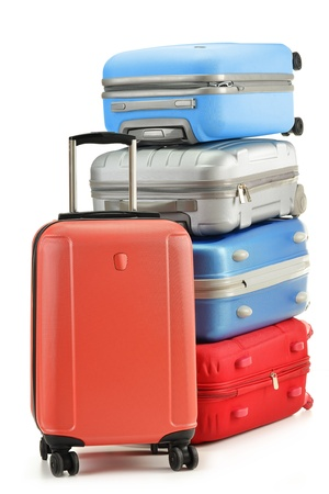 packing suitcase: Luggage consisting of polycarbonate suitcases isolated on white