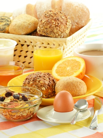 Breakfast including rolls, egg, cheese, coffee and orange juice on the table Stock Photo - 11844524