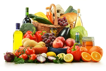 raw food: Composition with groceries and basket isolated on white. Vegetables, fruits, wine and bread.