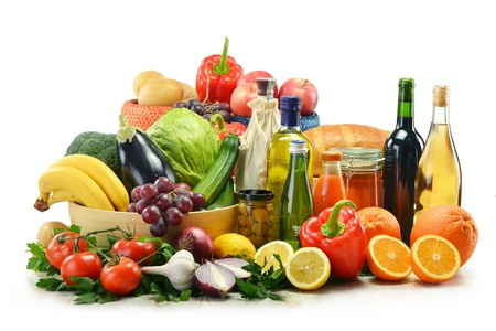 Composition with groceries and basket isolated on white. Vegetables, fruits, wine and bread. Stock Photo - 12457317