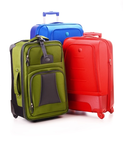 Luggage consisting of three large suitcases isolated on white photo