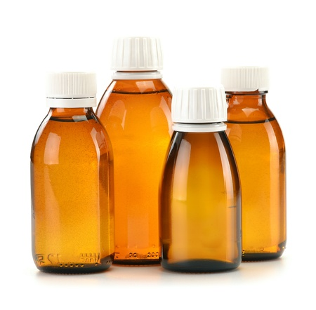 painkillers: Bottles of syrup medication on white background