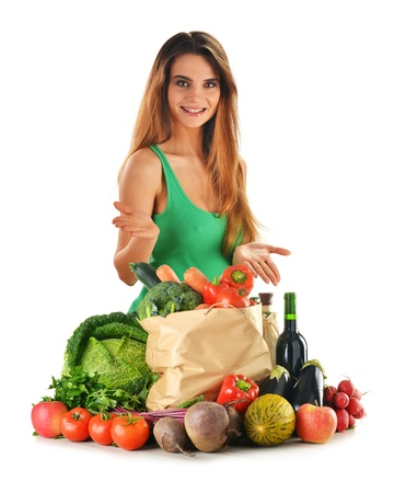balanced diet: Young attractive woman with groceries isolated on white
