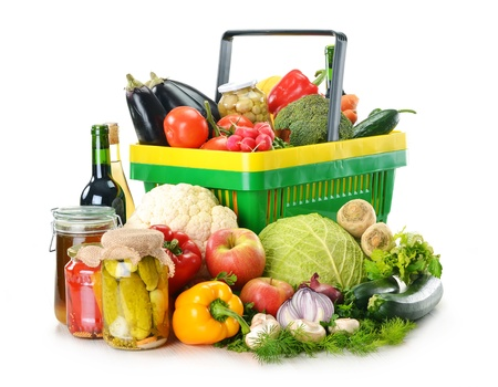Composition with plastic shopping basket and grocery isolated on white Stock Photo - 12952824