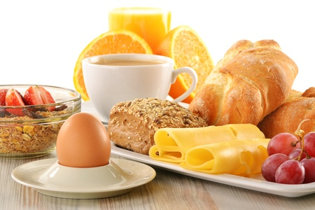 Breakfast with coffee, rolls, egg, orange juice, muesli and cheese Stock Photo - 13108521