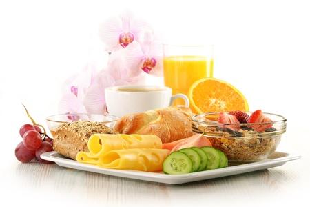 Breakfast with coffee, rolls, egg, orange juice, muesli and cheese Stock Photo - 13108512