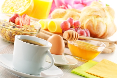 Breakfast with coffee, rolls, egg, orange juice, muesli and cheese photo