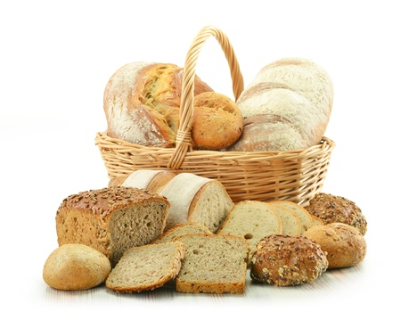 Composition with bread and rolls in wicker basket isolated on white Stock Photo