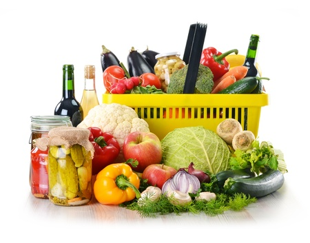 Composition with plastic shopping basket and grocery isolated on white Stock Photo - 13660831
