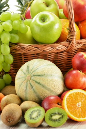Composition with assorted fruits in wicker basket isolated on white Stock Photo - 14232913