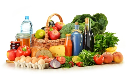 Groceries in wicker basket including vegetables, fruits, bakery and dairy products and wine isolated on white Stock Photo - 14732625