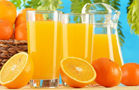 Composition with two glasses of orange juice and fruits photo
