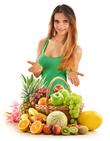 Young woman with assorted fruits in wicker basket isolated on white Stock Photo - 14826563