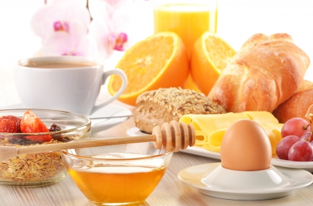breakfast table: Breakfast with coffee, rolls, egg, orange juice, muesli and cheese