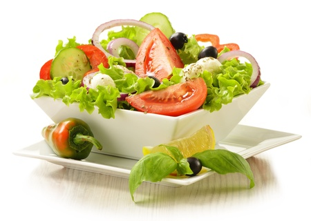 Vegetable salad bowl isolated on white Stock Photo - 15076745