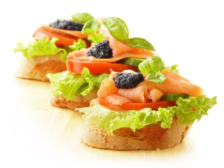 tapas: Three sandwiches with salmon and caviar  Fish snack