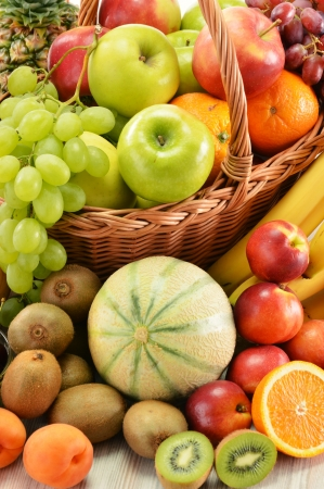 Composition with assorted fruits in wicker basket isolated on white Stock Photo - 15822990