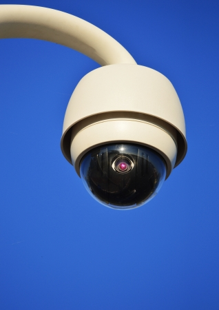 dome type: Hi-tech dome type camera over a blue sky