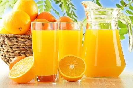 Composition with two glasses of orange juice and fruits Stock Photo - 16314073