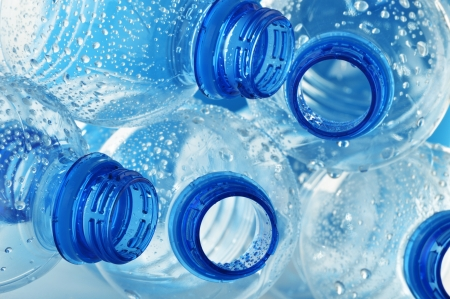 Composition with empty polycarbonate plastic bottles of mineral water photo