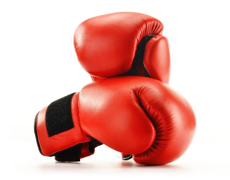 boxing equipment: Pair of red leather boxing gloves isolated on white