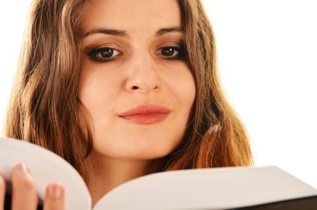 Young woman reading a book isolated on white  Female student learning photo