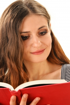 Young woman reading a book isolated on white. Female student learning photo