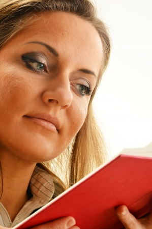 homework student: Young woman reading a book. Female student learning
