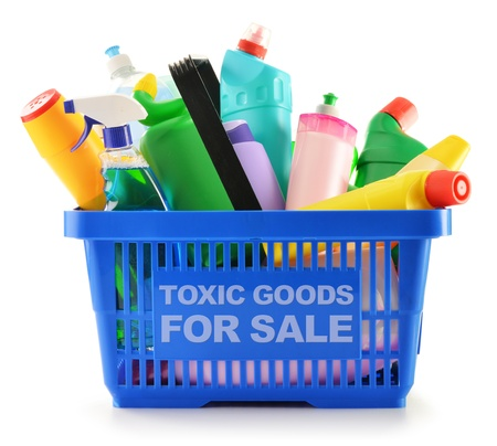 chemical hazard: Shopping basket with detergent bottles and chemical cleaning supplies isolated on white