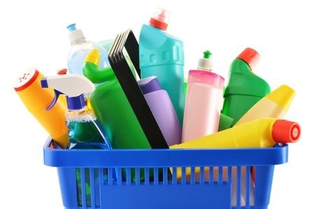 Shopping basket with detergent bottles and chemical cleaning supplies isolated on white Stock Photo - 17529832
