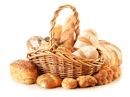 bread basket: Composition with bread and rolls in wicker basket isolated on white Stock Photo
