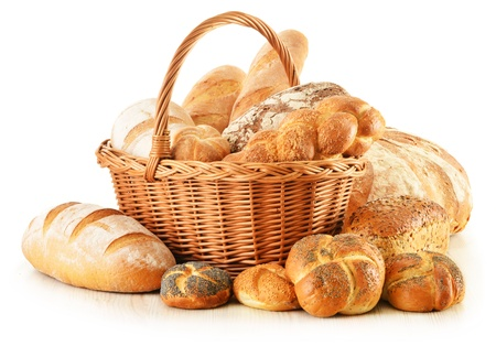 loaves: Composition with bread and rolls in wicker basket isolated on white Stock Photo