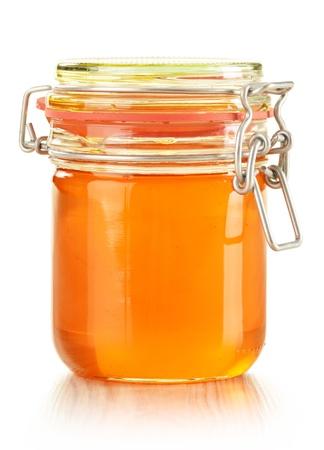 honey jar: Jar of honey isolated on white background
