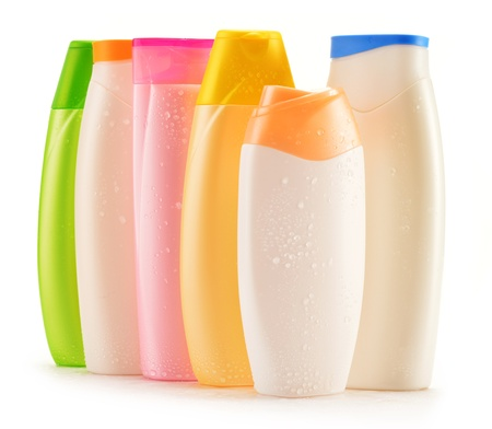 milk containers: Composition with plastic bottles of body care and beauty products