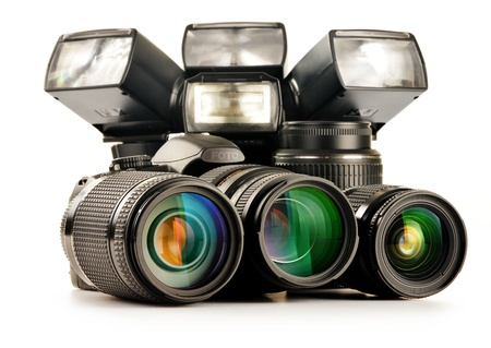 Composition with photo equipment including zoom lenses, camera and flash lights isolated on white Stock Photo - 17546040