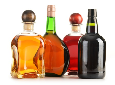 alcohol bottles: Composition with bottles of assorted alcoholic products isolated on white
