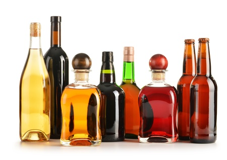 distilled alcohol: Composition with bottles of assorted alcoholic products isolated on white