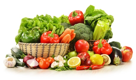 fruit basket: Composition with raw vegetables in wicker basket isolated on white