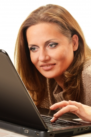 Young woman surfing on the Internet Stock Photo - 17803381