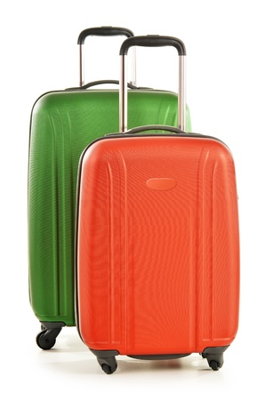 Luggage consisting of large polycarbonate suitcases isolated on white photo