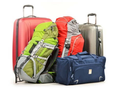 haversack: Luggage consisting of large suitcases rucksacks and travel bag isolated on white