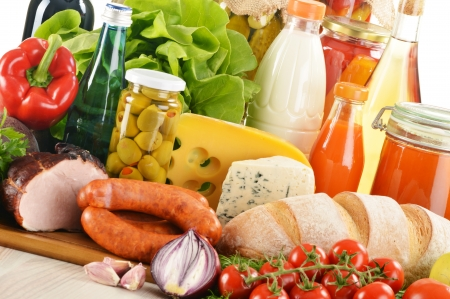 Composition with variety of grocery products including vegetable, fruits, meat, dairy and wine photo