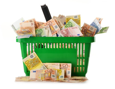 Composition with Euro banknotes in shopping basket  European Union currency photo