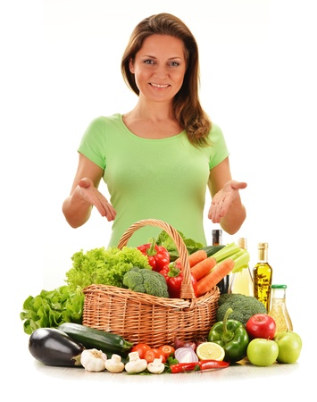 Young woman with variety of vegetables isolated on white background photo